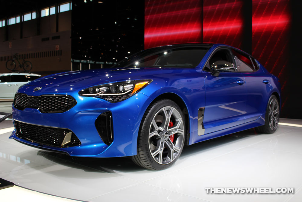 2018 Kia Stinger blue sedan car on display Chicago Auto Show