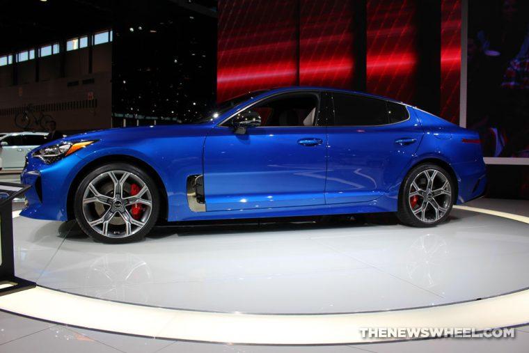 2018 Kia Stinger blue sedan car on display Chicago Auto Show