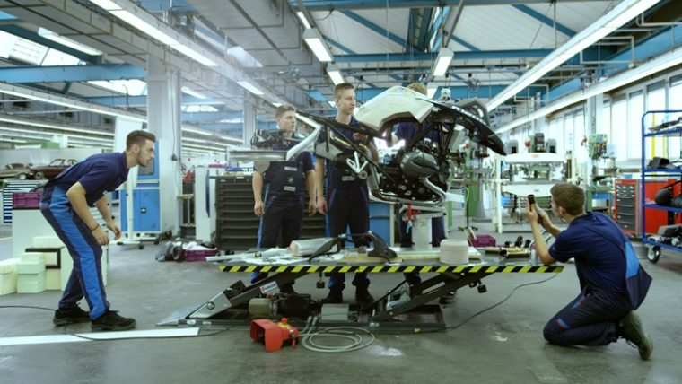 Team members from BMW Junior Company Munich working on the full-size replica of the LEGO Technic Hover Ride