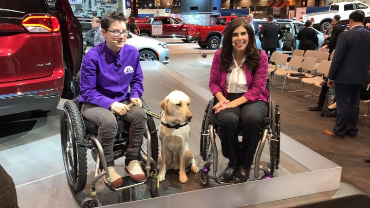 Cheryl Angelelli and Wallis Brozman, along with her service companion Mork, during the Chicago Auto Show