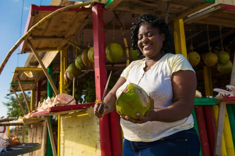 You can even visit a friendly coconut vendor during your journey Photo: Island Routes Caribbean Adventures