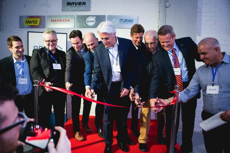 DRIVE's launch team commemorates the smart mobility innovation center's opening in Tel Aviv, Israel.