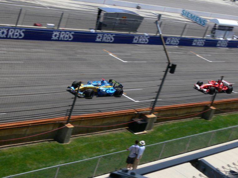Alonso's championship-winning Renault ahead of Felipe Massa's Ferrari