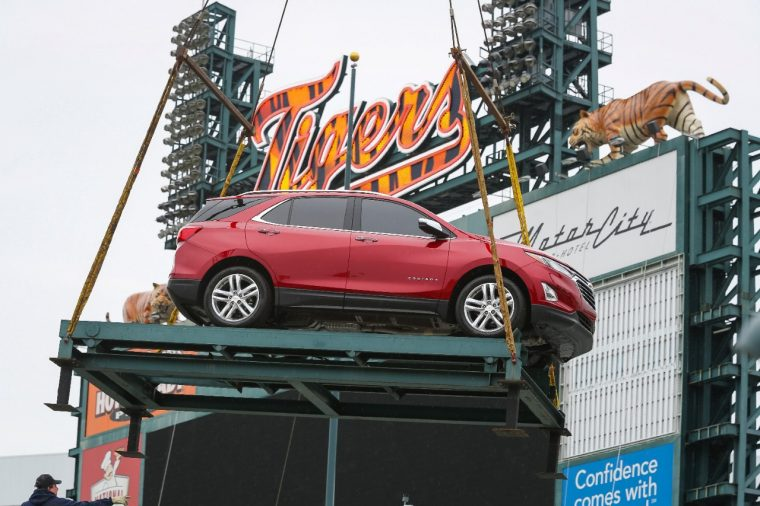 A red 2018 Chevy Equinox being put above Chevrolet Fountain at Comerica Park