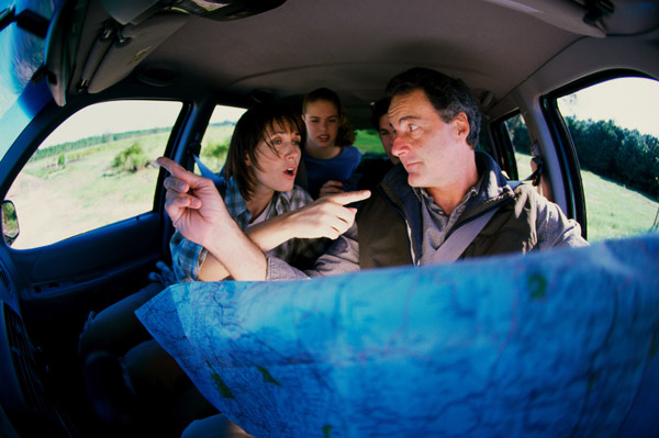 people arguing over map in car