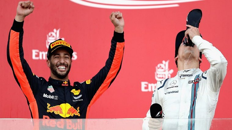 Ricciardo celebrates next to Stroll