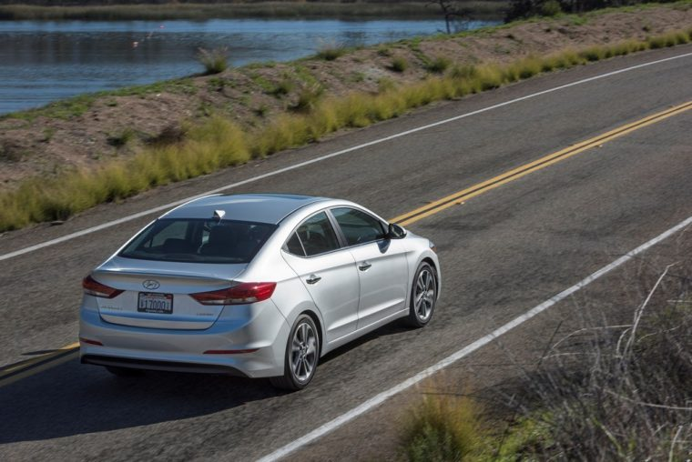2018 Hyundai Elantra Sedan Overview car model details driving on road