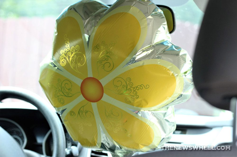 driving while transporting a balloon in car flower party