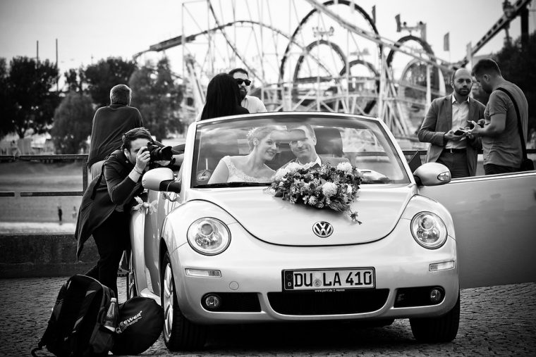 wedding newlyweds car