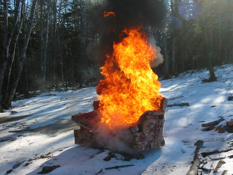 burning couch in snow