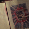 Necronomicon face in pages