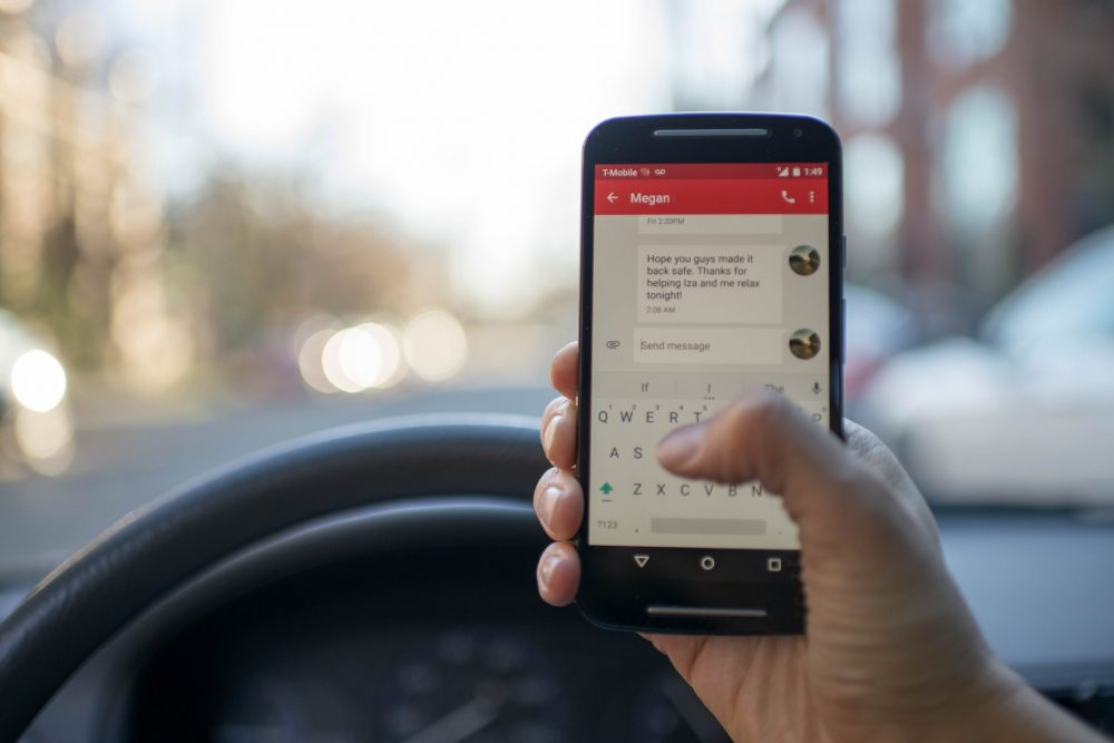 Close-up of a person Texting while Driving