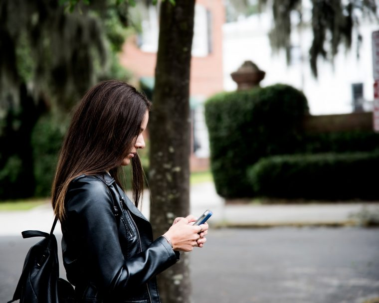 Girl texting on cell phone