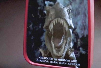 Jurassic Park rear view side mirror closer than they appear T-Rex scene car explanation