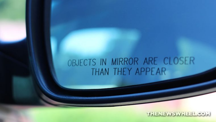 Objects in mirror are closer than they appear car side mirror disclaimer meaning reason convex