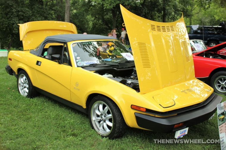 1980 Triumph TR8 yellow sports car hood pop British display