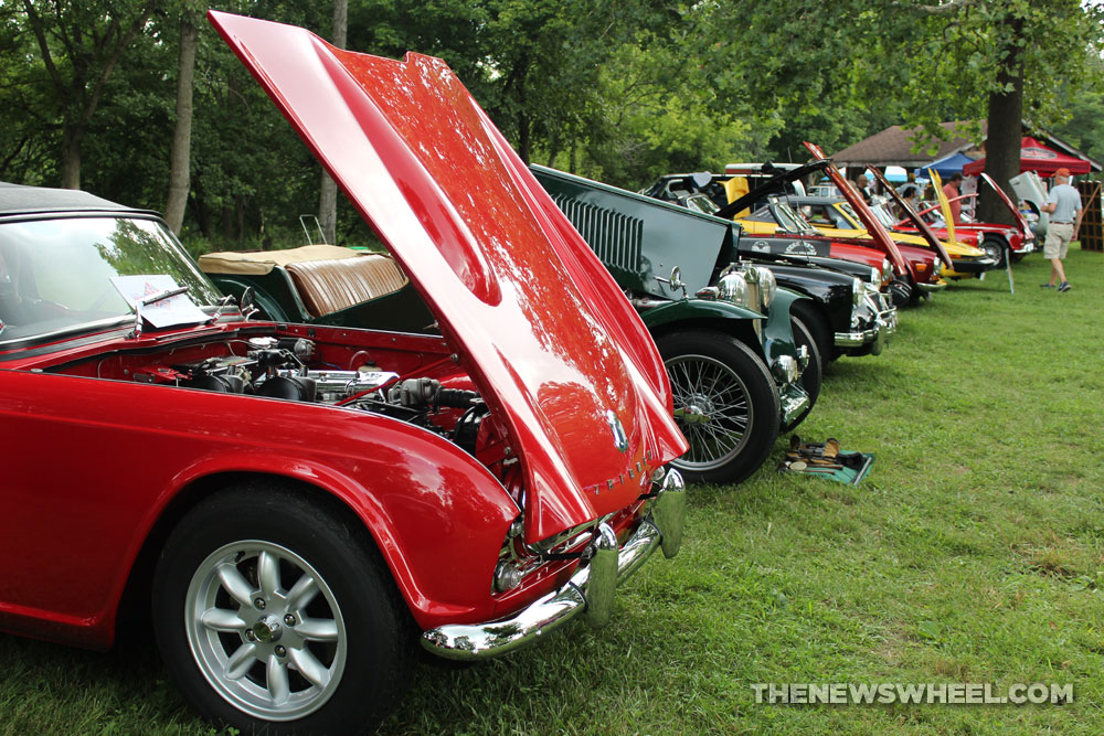 Vintage cars on display cruise in British vehicle show outdoors