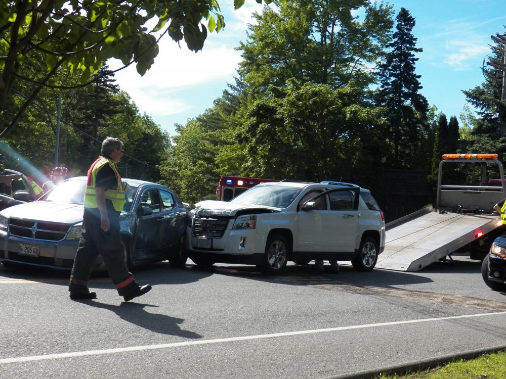 tow truck at a car accident scene