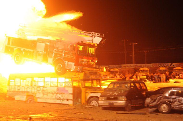Daredevil driver stunt car driver jump explosion thrill show
