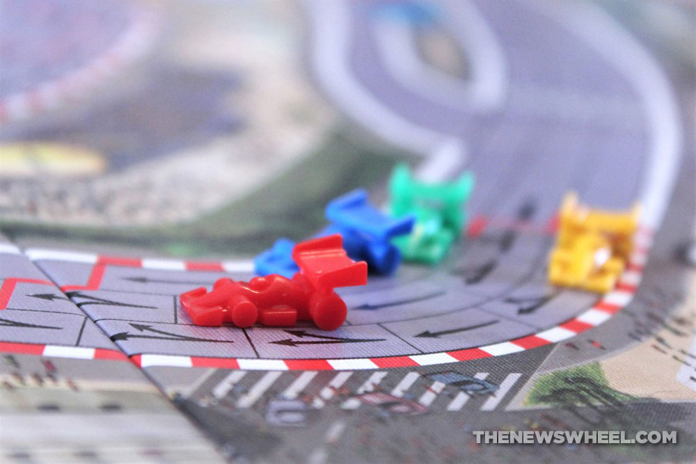 Close-up of car tokens in Formula De motor racing board game