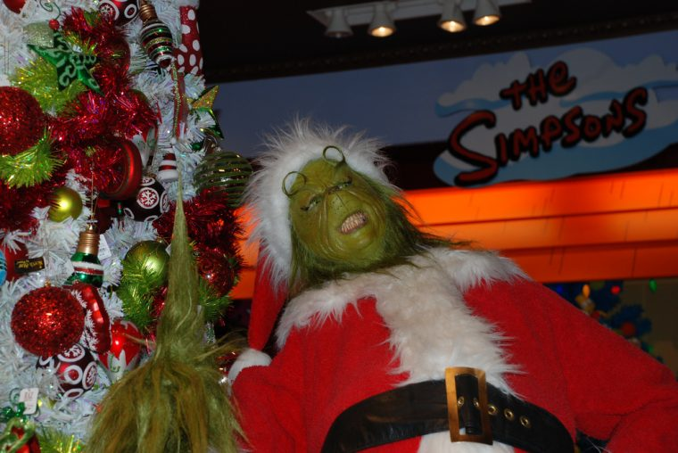 The Grinch Laughing by Christmas Tree