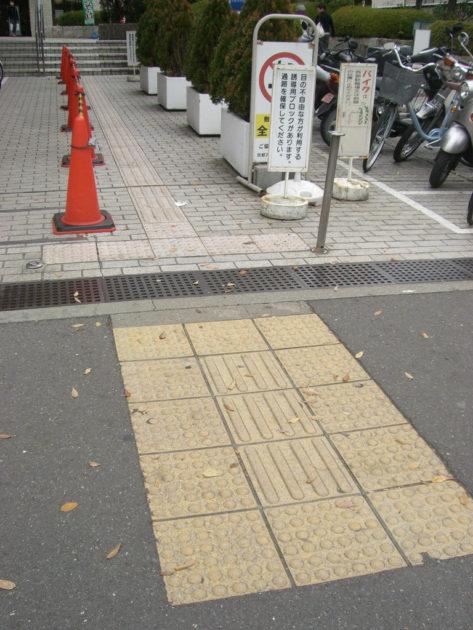 Seiichi Miyake Tenji bricks bumpy pavement tiles in japan crosswalk intersection