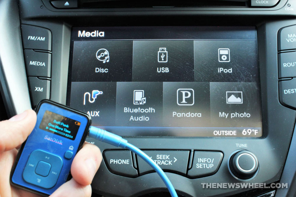 Audio MP3 device plugged into sound system in car