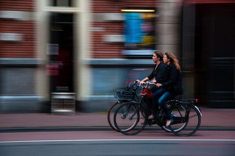 women on bicycle cycle lane city