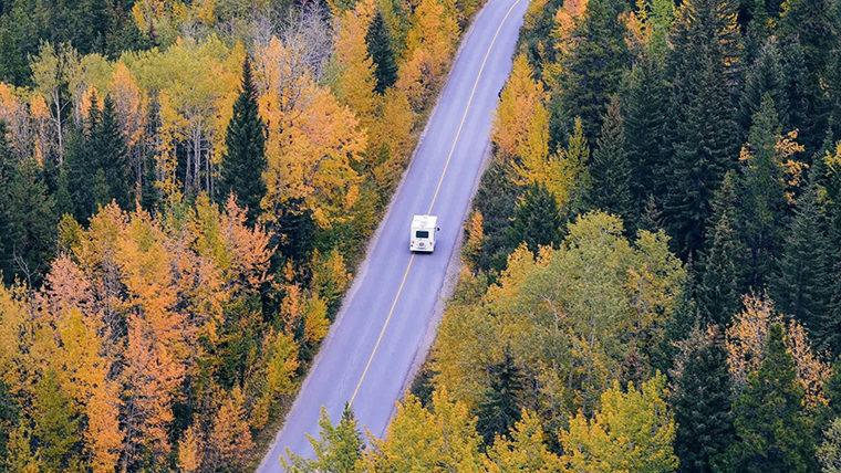 Camper Van on Autumn Road