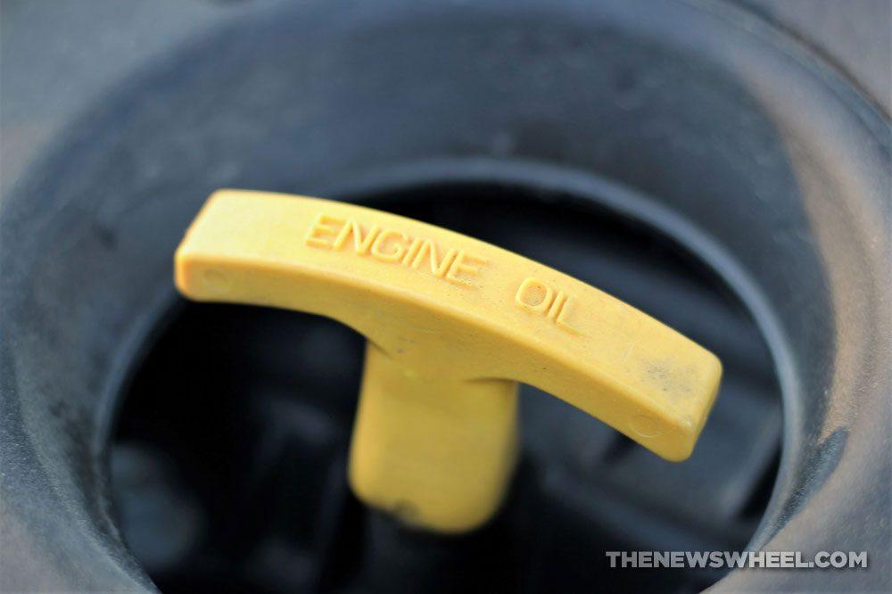 Engine oil dipstick oil change