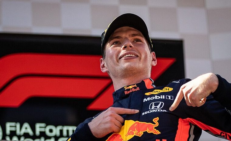 Verstappen Points to Honda Logo on Podium