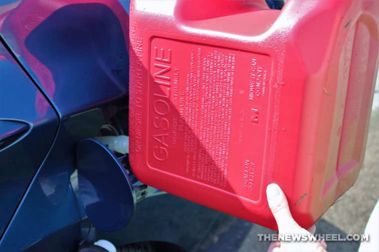 Gasoline can pouring emergency gas fill red refuel