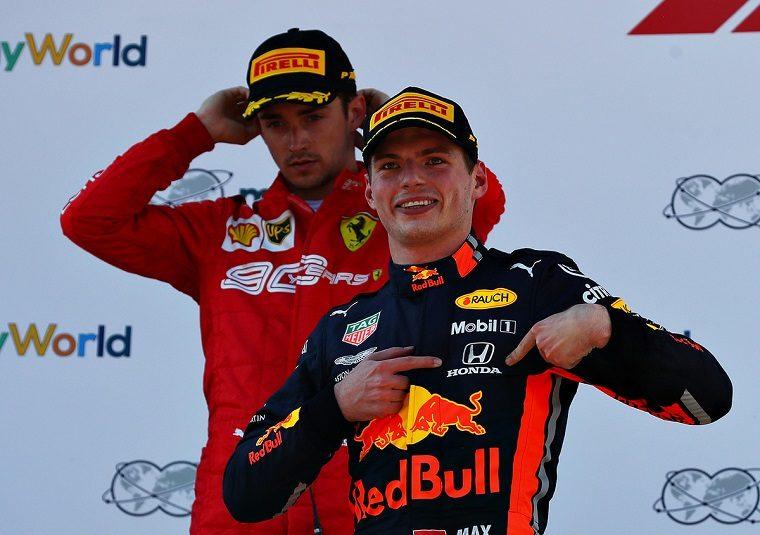 Verstappen Points at Honda Logo