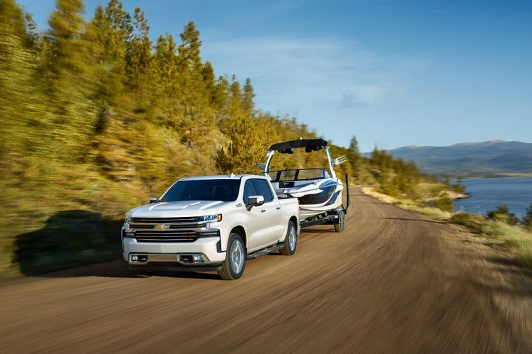 2019 Chevy Chevrolet Silverado white towing boat