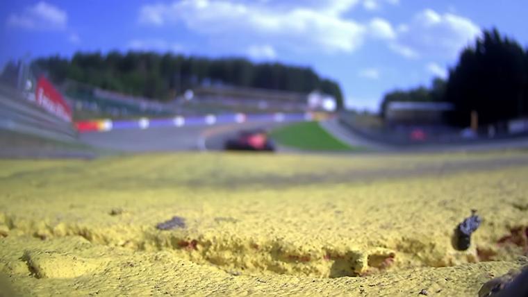 Charles Leclerc racing through Eau Rouge