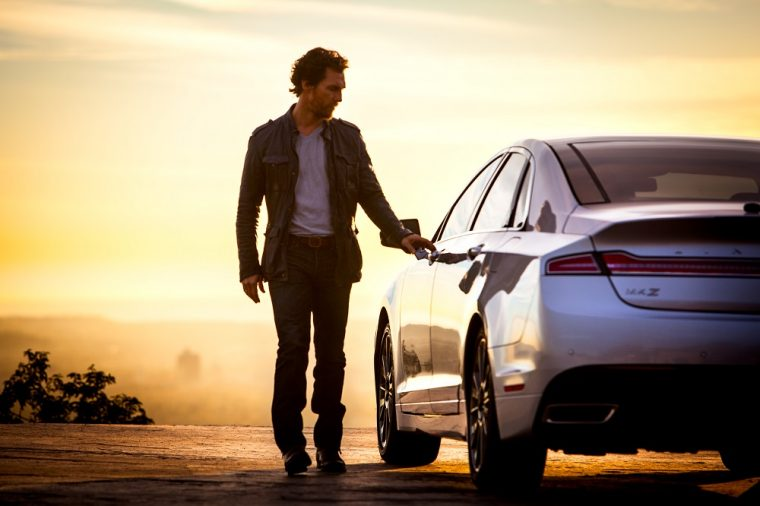 Matthew McConaughey with a Lincoln MKZ.
