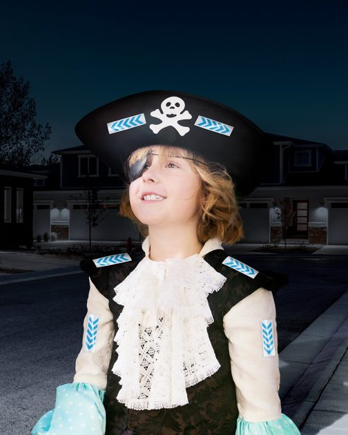 A child wearing a pirate costume with Glow Guards