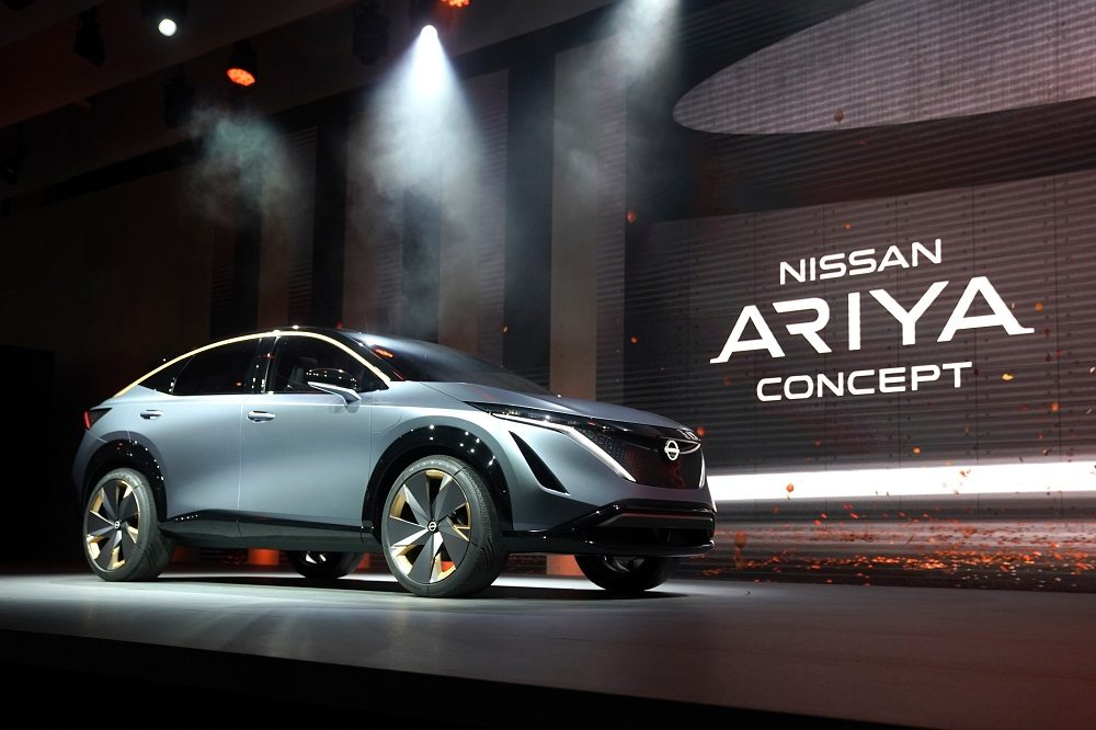 A light blue Nissan Ariya on stage