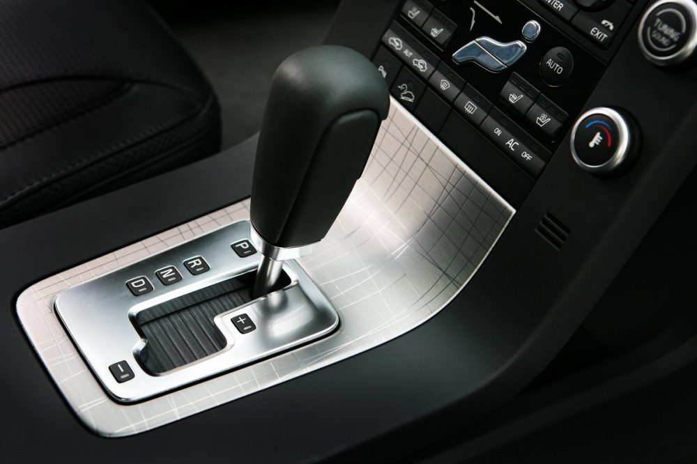 automatic transmission gear shifter in a car's interior