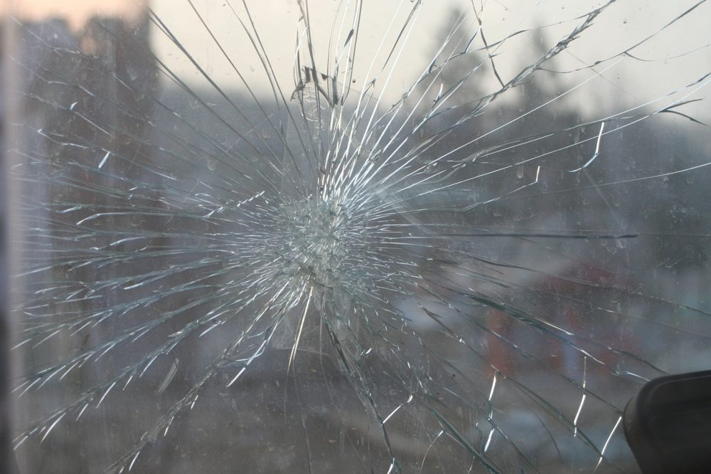 windshield with a large crack in the middle