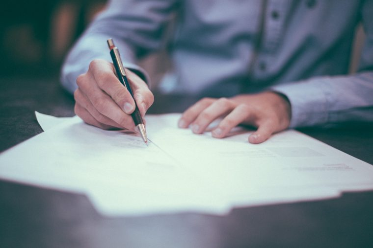 signing car title loan paperwork