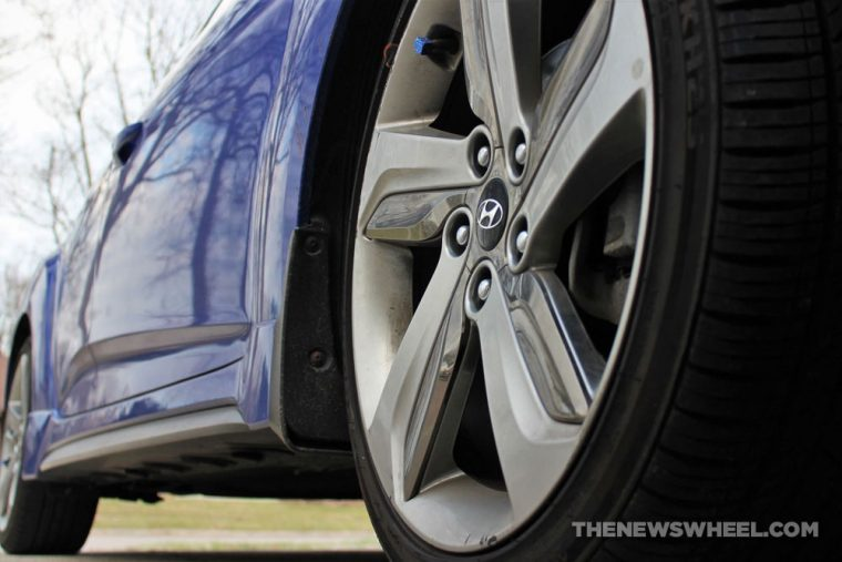 Close-up of a car wheel on a blue car