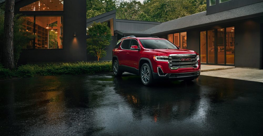 A red 2020 GMC Acadia, much like the one I nearly backed into another car the first time I tried to drive.
