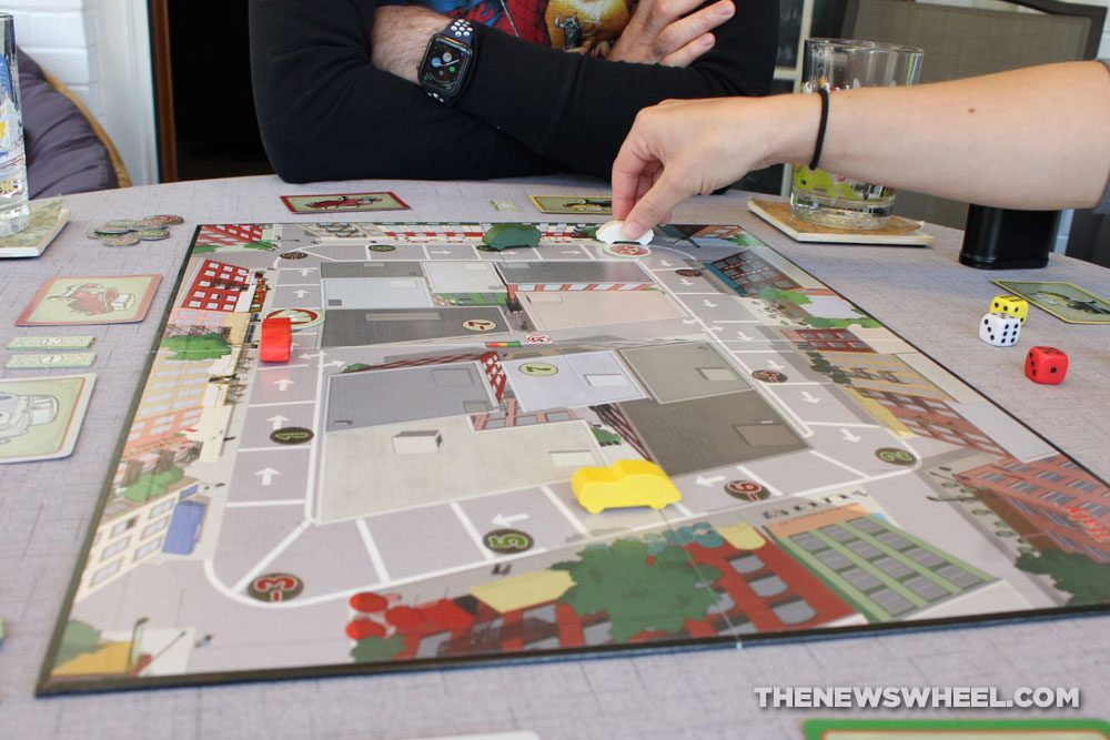Little Italy review Reiner Knizia Playroom 2007 Italian mobster racing board game funny family board town