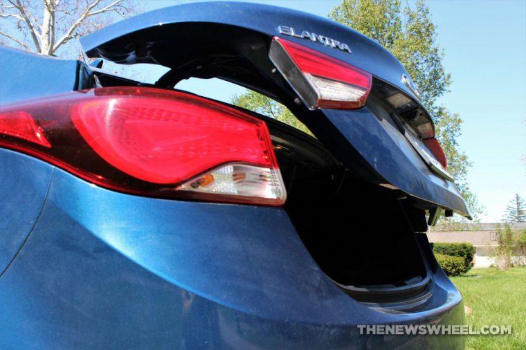 car trunk open hatch latch release popped