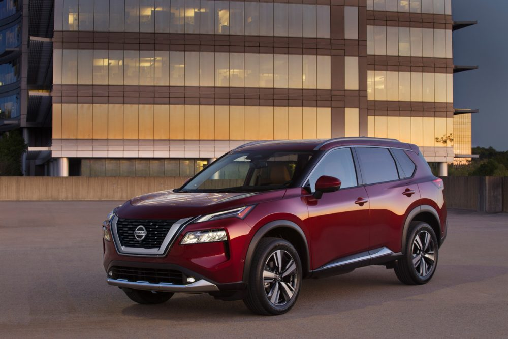2021 Nissan Rogue in front of a large building