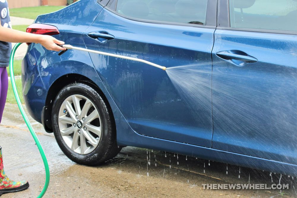 pressure washer cleaning your car wash spray water hose avoid damage tips