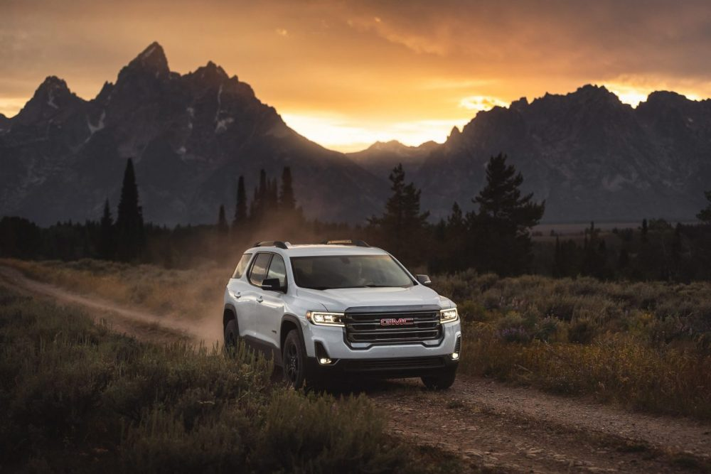 2020 Acadia AT4 driving off-road by a mountain range
