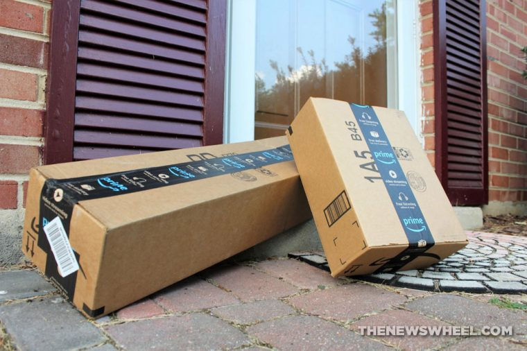 Amazon delivery boxes sitting on a porch outside a front door