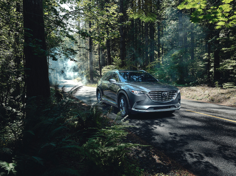 2021 Mazda CX-9 driving down a forested path